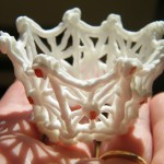Close up of royal icing crown with sugar jewels.