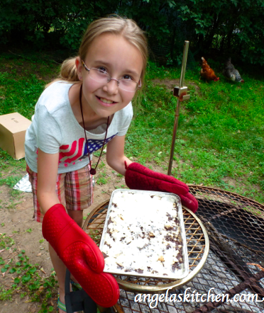My littlest cooking assistant showing off Gluten & Dairy Free Box Oven S'more Brownie Bars